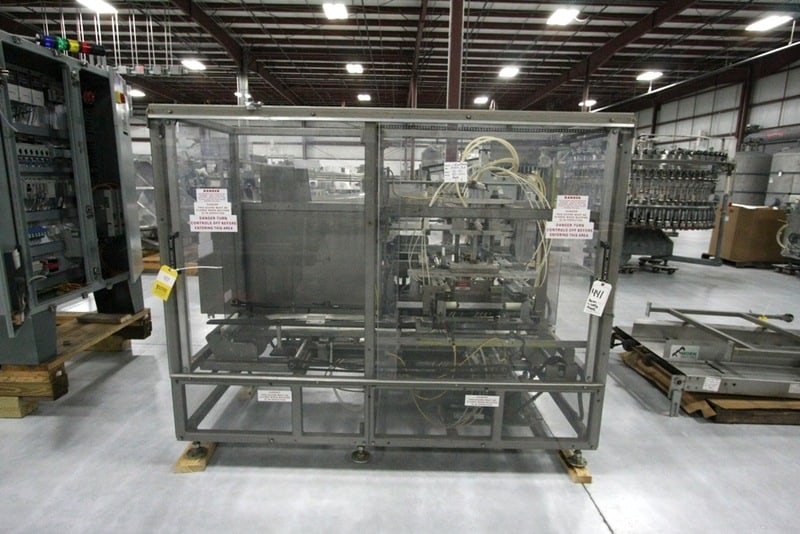 Moen BL901 Case Lidder, Allen Bradley SLC 5/03 PLC. Quick Panel Touch Screen. Extended Lid 58 Hopper. Rate of Production: Up to 28 c.p.m, Size Capacity: Length 10in Min – 24in Max, Width lOin Min – 18in Max. Depth 8in Min – 14in Max, Air usage per cycle in SCFM 1.209, Model: BL901, Serial Number: 901-1490