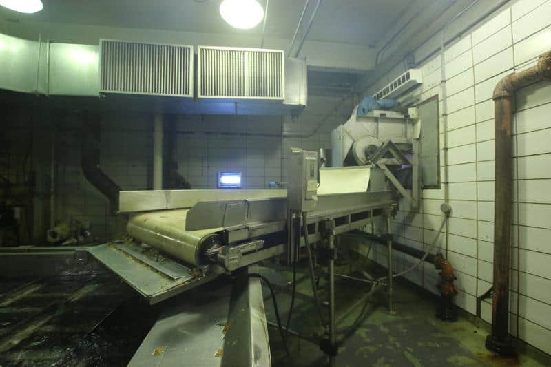 "Approx 11' L x 3'4"" W Infeed Conveyor Mounted on Casters, Feeds into Water Bath"