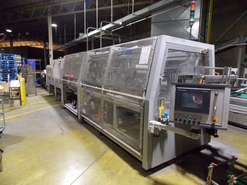 Kisters KHS SP040 Shrink Wrapper Bundler Serial: 2443 Year: 2003, Uses Film Only - NO Tray, Last packing 6 pack and 12 pack juice bottles with print registered film, Allen Bradley controls with Panelview 600 Touch Screen, 40ft total length, Speeds up to 40 cases per minute(Located in North Carolina) ***FBEV***