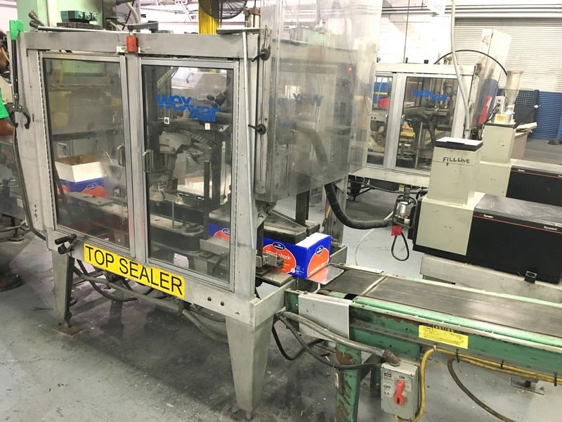 Wexxar Automatic Top Glue Case Sealer Model: WSH-06 Serial: 1357, Runs around 15 cases per minute, Removed from production June 2017, Includes ITW Dynatec Glue System (Located in North Carolina) ***FBEV***