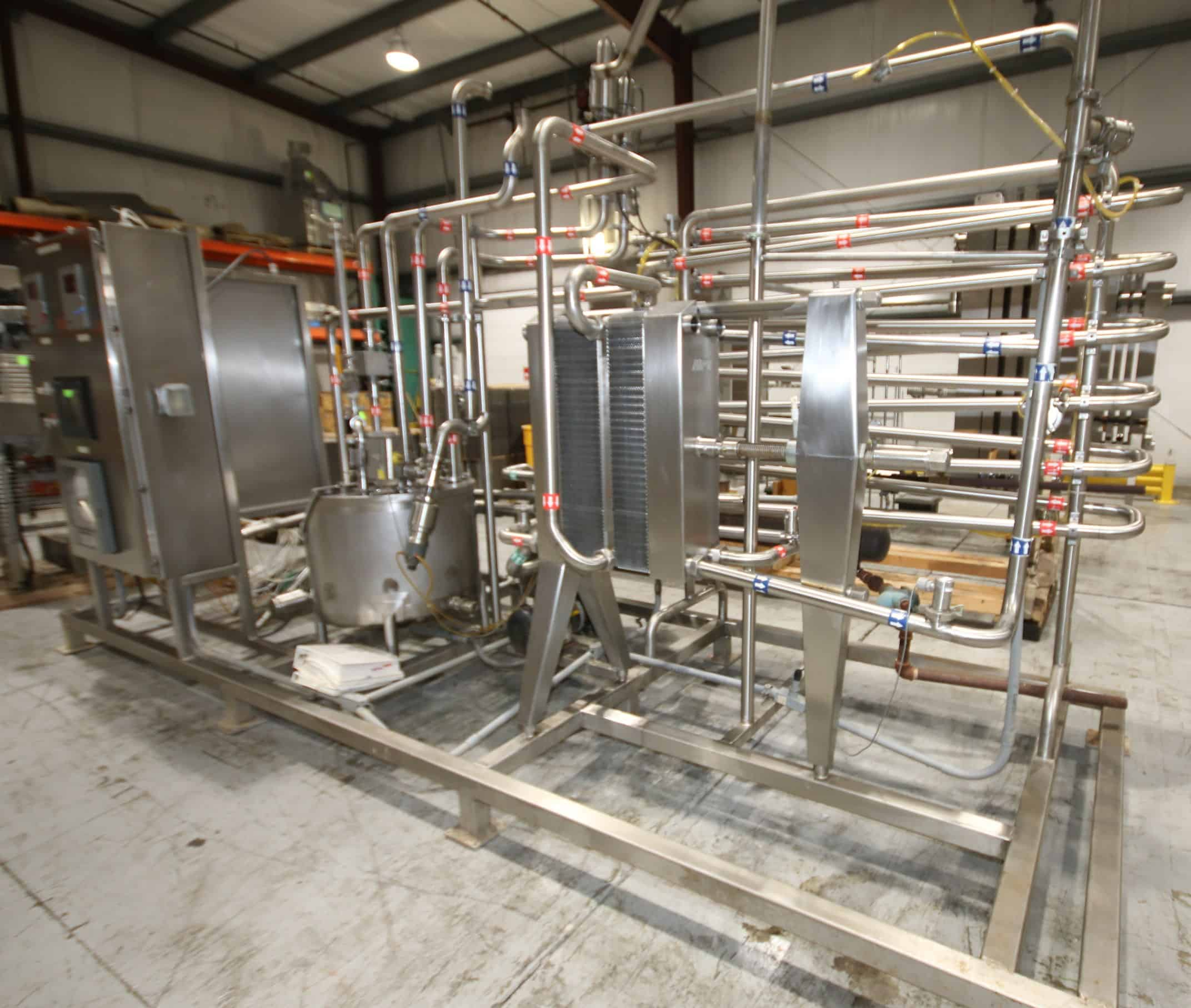 "Omni Integrated Solutions 33 GPM Skid-Mounted Cheese / Milk HTST System with APV Plate Pasteurizer, S/N 53-320 with (1) Divider, (71) Plates, 2"" Nested Holding Tubes, Tri-Clover 2"" Flow Diversion Valve, Allen Bradley MicroLogix 1000 Legal PLC Controller, Balance Tank, Shell and Tube Heat Exchanger with Make-Up Tank and Pump, Tri-Clover 2 hp and 7-1/2 hp Pumps, Anderson 2"" Flow Meter with Digital Read-Out, Related Valves and Piping, (4) On-Board Control Panels - (1) with Allen Bradley SLC 5/04 CPU Controls, PanelView 1000 Touchpad Display, Allen Bradley 7.5 and 3 hp PowerFlex 400 VFD's, Anderson AV-900 Chart Recorder, Anderson Differential and Temperature Controls (**SUBJECT TO CONFIRMATION**), M. Davis Group, Showroom Auction, Pittsburgh, PA"