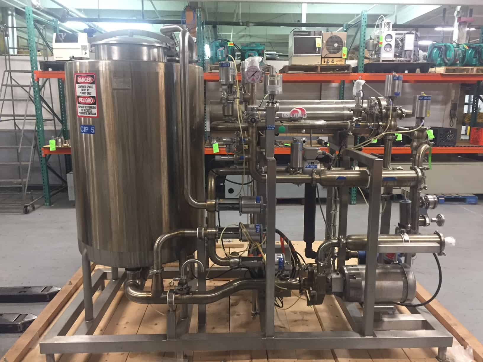 """Sani-Matic Skid Mounted S/S CIP System, Job #40737, Item # 01-200661, with 200 Gal. S/S Tank, 2011 Enerquip S/S Shell & Tube Heat Exchanger BN 10486, SN 12784, MAWP 150 psig @ 375 degree F, Fristam 10 hp S/S Centrifugal Pump, Endross Hauser 2"""" Flow Meter with Read-Out, Inline Filter, Gea, WCB & Sudmo Air Valves, Check Valves, Temp Sensors, Gauges, S/S Enclosure with Allen Bradley Flex IO Controls, Foxboro Conductivity Meter, Solenoids & Breakers Mounted in S/S Enclosure, (CIP Dim. 9 ft L x 4 ft W x 85"""" H), Skid Dim. 10 ft L x 90"""" W x 90"""" H)"""