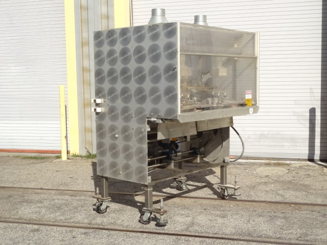 PMS Tray Former, Model # GF60D, S/N 551, dual forming heads with dauber-style hot melt glue closure (Located in South Carolina)***NORTH***