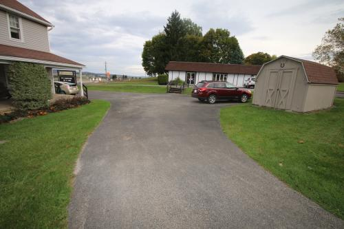 Property A:  5578 Rt. 981, Latrobe, PA 15650, Aprox. 2,400 SF, Single Story, Slab-On Building, Zoned Commerical, with Kitchen Area, Restroom, and Shop Area