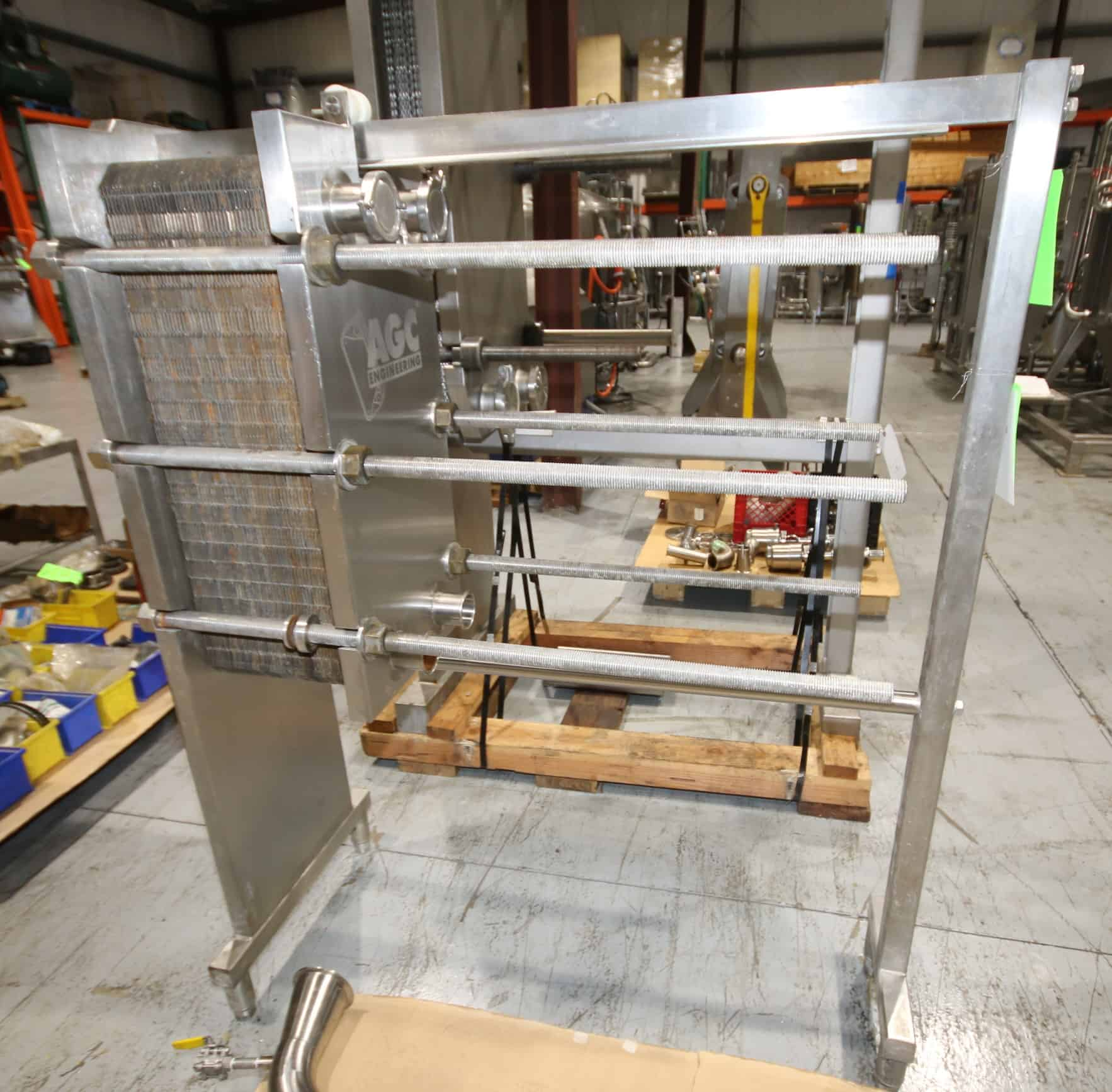 2005 AGC S/S Cream Plate Press, Model PRO2-SH, S/N 0525, Max. Temp. 250 Degree F, Max. Pressure 150 psi with (97) Plates includes Pallet of S/S Pipe Connectors, Temperature Sensors and Gauges