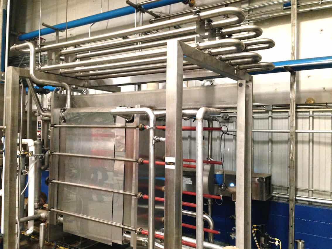 Barry-Wehmiller Flash Pasteurization Skid Serial 61180 Year: 2011, Setup for Juice or Lightly Carbonated Cider, 100 Gallons/Minute, Incoming Product Temperature 65ºF minimum – incoming product temperature max is 85ºF, Target Hold Time 15 seconds, 460 Volts, 3PH, 60HZ, Water 40 PSIG, Air 80 PSIG, Steam PSIG, Includes APV Multi-Section Plate Heat Exchanger – Model R5 R-15, 150 PSIG at 293ºF Max Temperature, Holding Tube for Pasteurization, Control and Steam Valves, Stainless Steel Construction, Fristam High Pressure Pumps, Allen Bradley Control Logix PLC with PowerFlex Frequency Drives and Operator Panelview 1000 Touchscreen, Optimum Filter Stainless Steel Flash Buffer Tank at 250ºF, Used 6 months before change in production requirements(Located in North Carolina) ***FBEV***