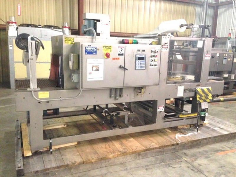 Arpac 25TW-28 Tray Shrink Wrapper and Heat Tunnel Model: 25TW-28 Serial: 3764, Last used for bottles in trays and cans in boxes, 28 inch wide 12 inch tall seal bar, Runs up to 20 packages per minute, 34 inch infeed/discharge elevation, Left hand machine, Allen Bradley SLC 5/03 PLC with Allen Bradley 160 VFD Drive, 460 Volts 3 Phase 60Hz, Central Point Lubrication, 80 PSI air minimum, Turbo Cooling(Located in North Carolina) ***FBEV***