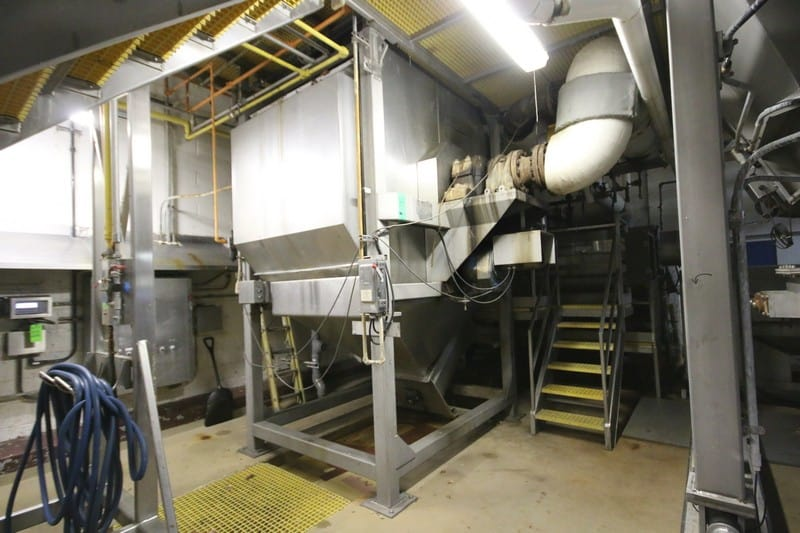 "Odenberg All S/S Vegetable Steam Peeler, S/N 91015, 11 ft. H x 5 ft. W x 9 ft. L Chamber, SEW 5 hp 1660 RPM Drive Motor, 300 psi @ 500 Degrees, with Controls, Also Includes Top Mounted S/S Feed Hopper on Load Cells with Digital Read Out, 14 Ft Bottom Mounted S/S Auger Conveyor System, Mounted Operators Platform, (Overall Dimension 10 ft. W x 9 ft. L x 13 ft. 4"" H or 18 ft. H to top of Feed Hopper)"