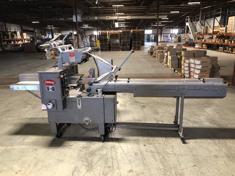 "DoBoy Scotty 2 Horizontal Flow Wrapper, S/N 93-1650, Capable of 60 PPM, Package Sizes Range from 4""-15"" L x 1-5-1/2"" W x Max 2-3/4"" H, 3 Formers, Set Up Currently for Printed Film, 5' Lugged Chain with (11) 1/2"" Centers, 2"" H Lugs, Equipped with 1-Up 9"" W Cross Seal Jaws, 240 V, Single Phase (Total Footprint: 118"" L x 36"" W x 68"" Tall) (Located in Kansas City, MO)***DCF***"