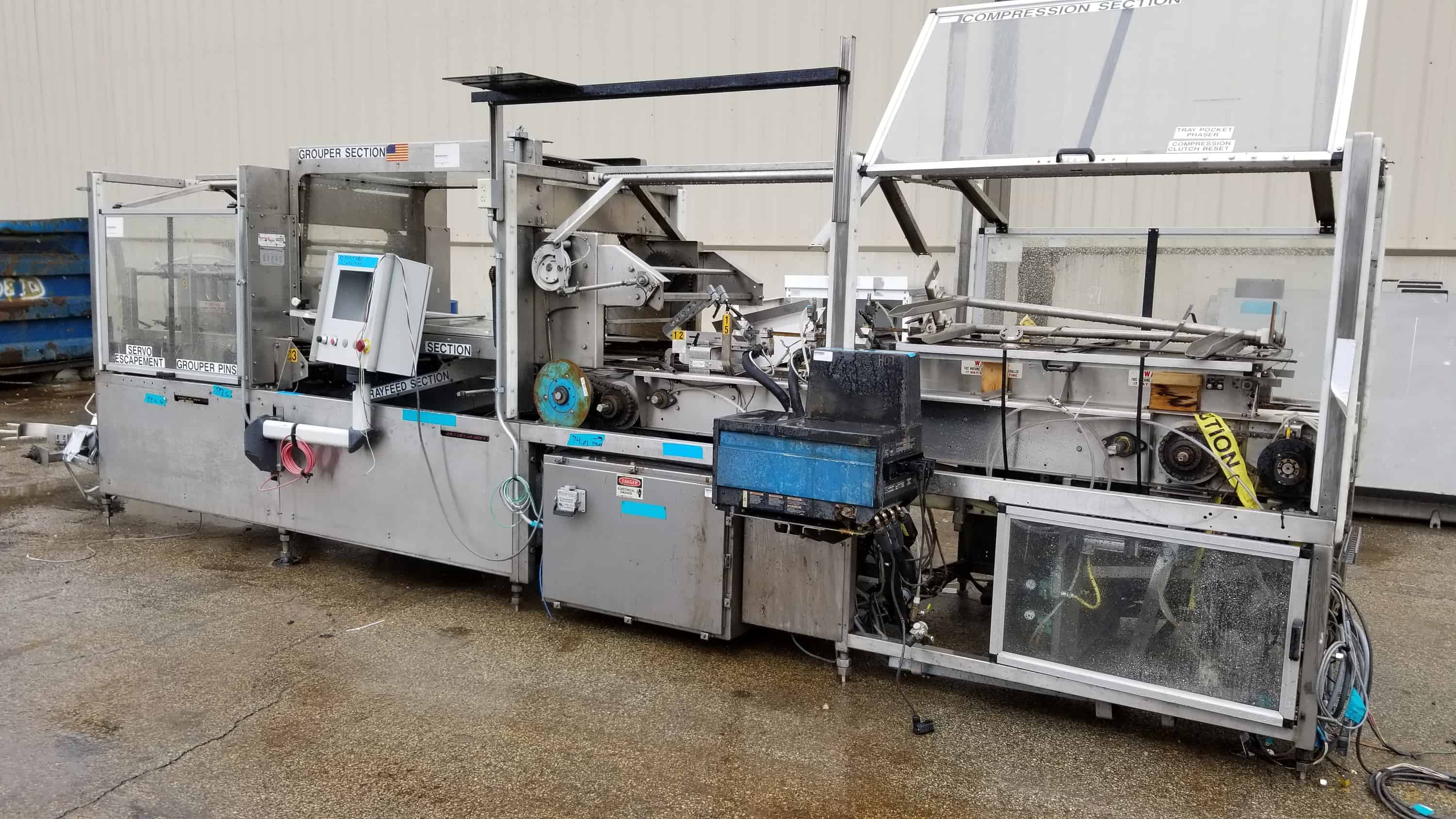 Standard Knapp S/S Tray Packer, Model CONTINUUM, S/N 296i-031, with Nordson Hot Melt Gluer, (Note: Missing Display), (Located Outside Main Packaging Area)