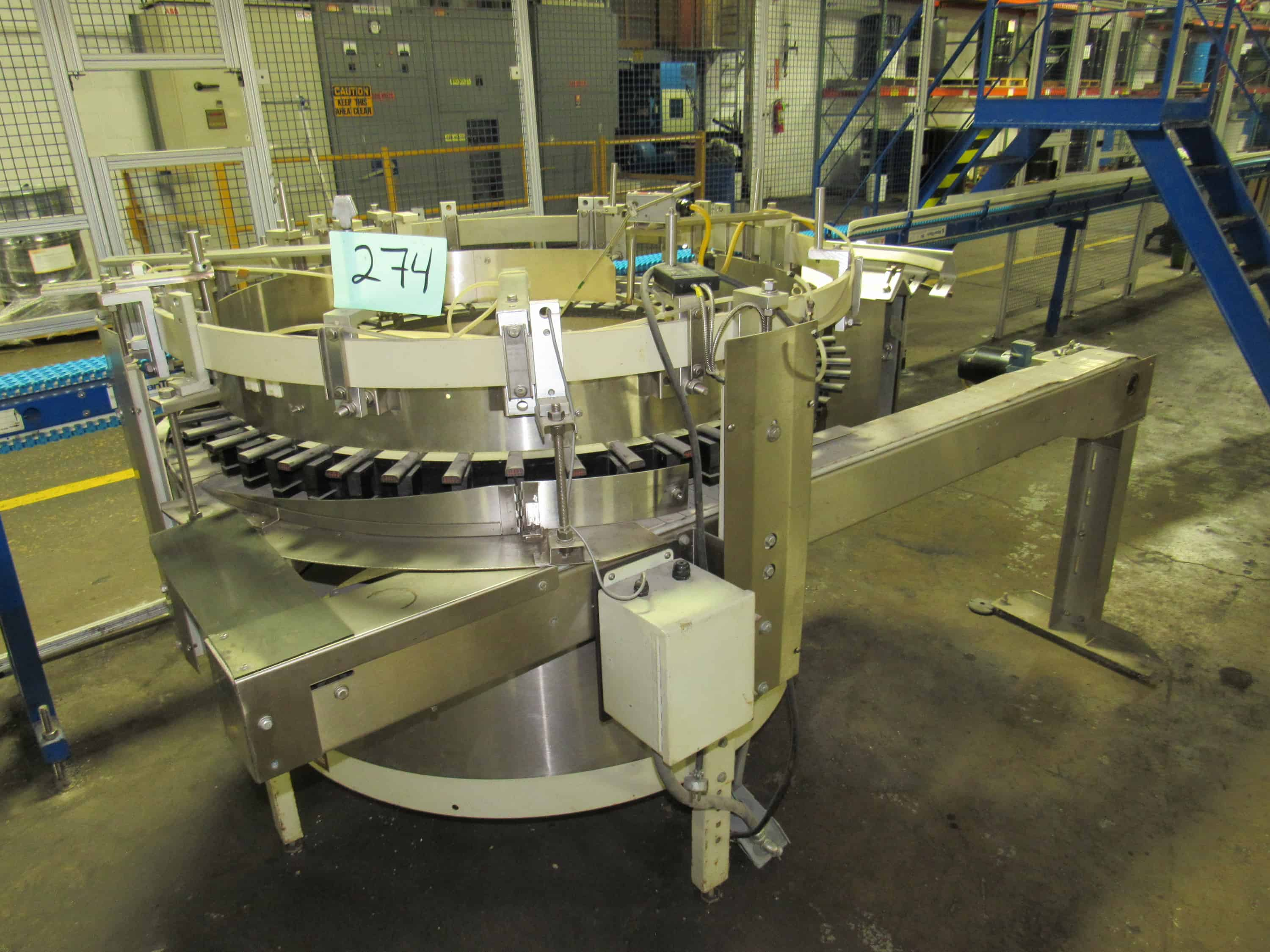 "Hopmann Bottle Unscrambler bottle erector stainless steel with 4.5"" wide outfeed belt conveyor.  (Rigging and loading fees included in the selling price - optional Palletizing $85.00)(Located in Iowa)***EUSA***"