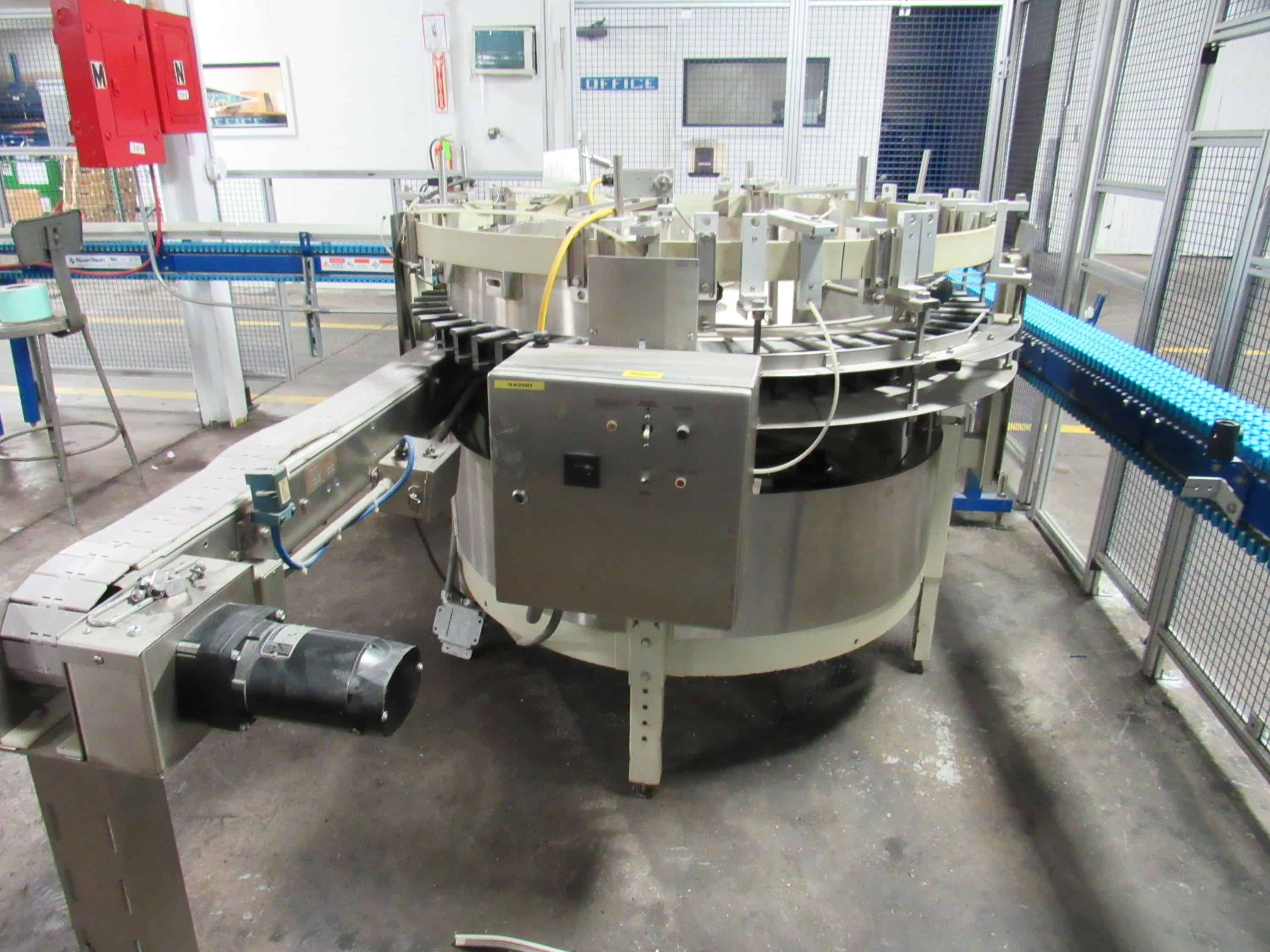 """Hopmann Bottle Unscrambler bottle erector stainless steel with 4.5"""" wide outfeed belt conveyor.  (Rigging and loading fees included in the selling price - optional Palletizing $85.00)(Located in Iowa)***EUSA***"""