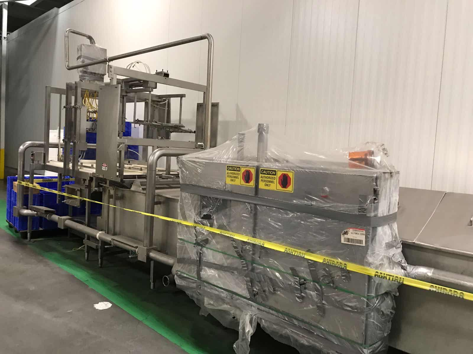 "Viking Hydra-Form Mozzarella Block Molder/Chiller System, S/N 97-036-RH, with Allen Bradley Panel View Plus 1000 Controls & 5/30 PLC. 54"" Wide Chill Tank, Tank Length for Chilling is 22' Lonf, Operational Width-Turning End with Cylinder 9' Long, Including Lift/Drop Area. Operational Width at Fill End 9'. Operational Length with Infeed & Discharge Shuttles is 35' Long, Molding Section is 80"" Long, Dual Auger All S/S. Molder Extruder Extends 48"" from Side at Filling End. (Located in California) ***RLF***"