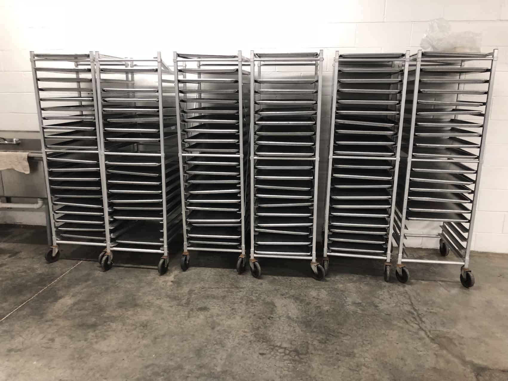 "(6) Channel approximately 64"" Tall Tray racks, mounted on casters, 20 Tray Capacity"