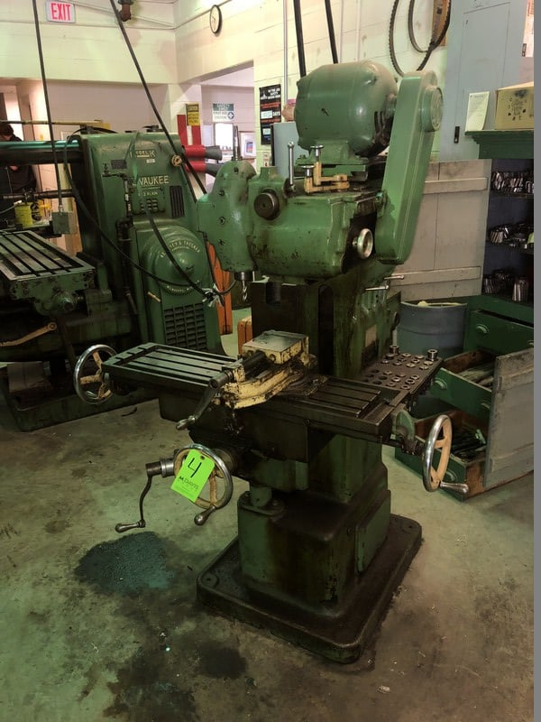 "Van Norman Vertical Milling Machine, Model 12, S/N 9115, with 37-1/2"" L x 19-1/2"" W Adjustable Table with Vise Mounted on Working Table"