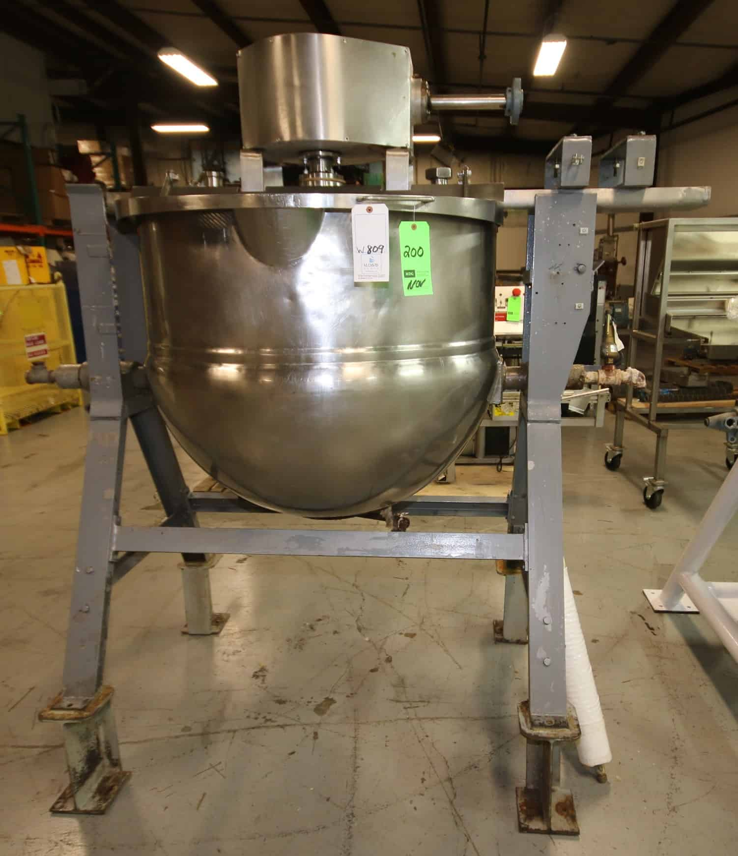 Lee 150 Gal. Steam Jacketed S/S Kettle, S/N A1133 with Bottom Side Scrape Surface Agitator with 3 hp / 1750 RPM Drive Motor, 208/230 - 460 V, 3 Phase with Hinged Lids and Tilt Capability, Mounted on Steel Frame, BN 1230, Jackete 90 psi @ 350 Degrees F, (W809)
