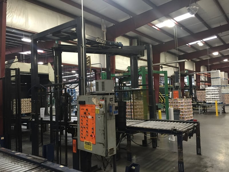 Orion MA44 Rotary Arm Pallet Wrapper, S/N: 4054162, Allen Bradley PLC Controlled, Includes Wrap Station, 10ft of Pallet Conveyor and Control Panel, Dims: 14' L x 12' W x 10' H, Speed: 50-60 Loads/Hour, Electricity: 460V 3PH 60HZ 15a
