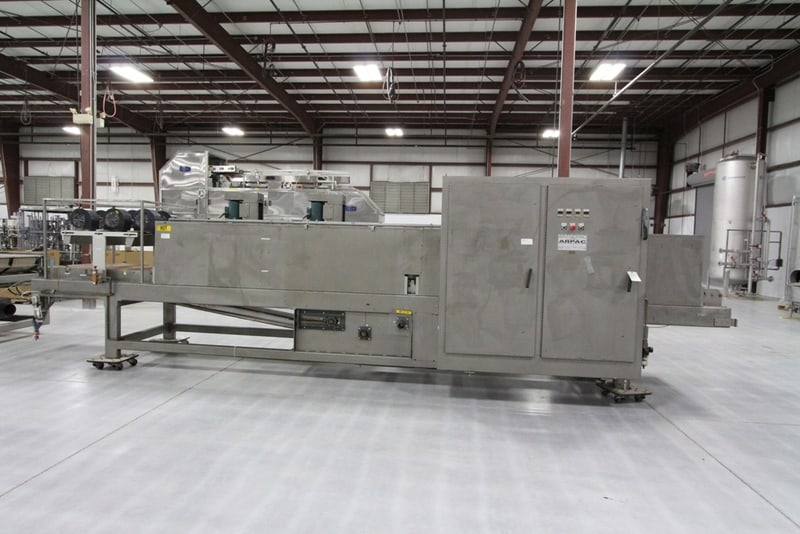 Arpac Shrink Wrapper Bundler with Heat Tunnel Automatic Wraps Bottles/Cans with Clear or Print Registered Film, No Trays or Pads, Uses FILM ONLY, Includes Infeed Spacing Conveyor, Wrapper, Heat Tunnel, Discharge Conveyor, Allen Bradley PLC, Currently setup for 6 packs but able to run other packages, S/N: 2178, Dims: 50 Ft L x 6 Ft W x 8 Ft H,Speed: Up to 60 Cycles/Minute (120 on Dual Lane), Electricity: 460v 60hz 3ph
