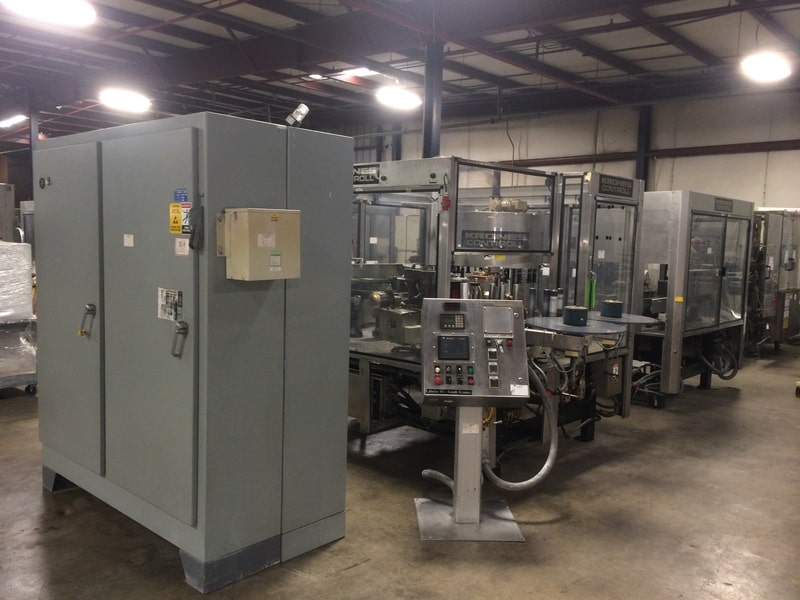 Krones Contiroll Roll Fed Labeler, S/N: 745-170 & 745-171, Allen Bradley SLC 5/04 PLC with AB PanelView 600, Setup for .5L and 20oz PET Bottles, Speed: 300 BPM, Electricity: 460V 3PH 60HZ