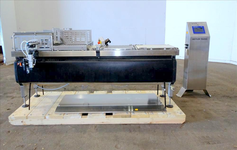 Mettler Toledo Checkweigher, Model BELTWEIGH XE. Has pneumatic reject system. Stainless steel construction. Serial no.: 14006321. 1/60/120V (Located in Chicago, IL)