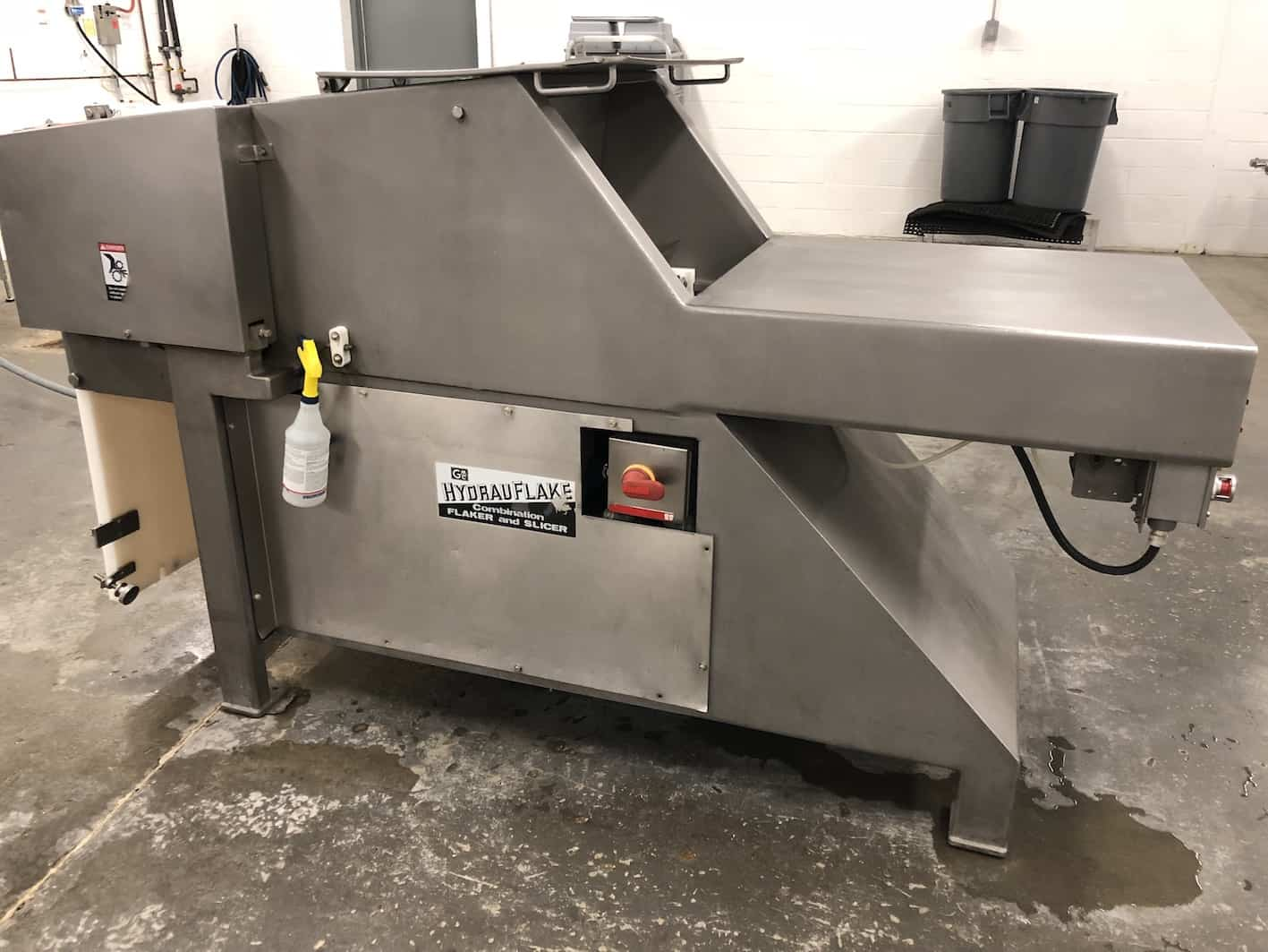 "Hydrauflake Combination Meat Block Flaker & Slicer, Model 2501, 10-Cycle Slice Blades Mounted on 12-1/2"" S/S Flow Through Drum Operating @ 540 RPM, Feeds Blocks Automatically with Adjustable Pneumatic Ram (80 PSI Pressure), Ram Can Be Started & Stopped as Desired for Controlled Batching W/O Turning Power Off, Block Capacity of 10"" x 24""x 24"" (25.4 cm X 60.96 cm X 60.96 cm), Powered by 10 HP, 230/460 V, 60 Hz, 3 Phase Enclosed Motor with Controls (Estimated Weight 2,500 LBS) (Shown Cycling) (DISMANTLED FOR CLEANING. UNIT COMPLETE AND IN OPERATING CONDITION)"