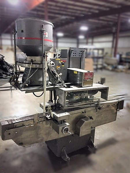"Resina Model P22 87, cap feeder (pump inserter) with cap torquer, comes with an extra vibratory feeder and two extra shoots; 4/5"" belt for infeed/outfeed conveyor."