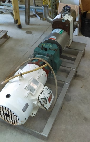 "APV Rotary lobe pump (no nameplate but appears to be model R6BS). 3"" threaded inlet/outlet. Driven by 10 HP, 230/460 Volt, 1755 RPM motor into gear. Unit mounted on Stainless Steel base. Last used in sanitary food plant, bakery. Dough pump. No lobes installed. (Located in New Jersey)"