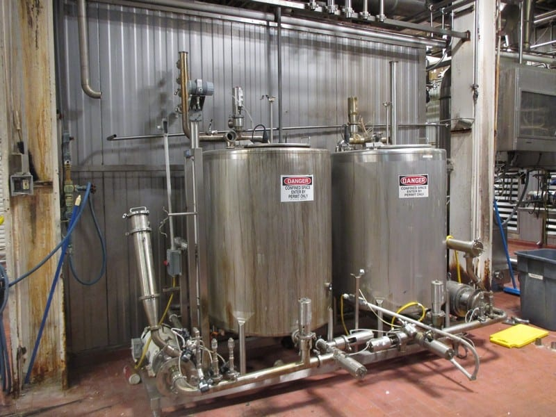 2-Tank Skid-Mounted Dual CIP Sytem, System Includes (2) Pumps (1) Fristam (1) Alfa Laval, (2) Inline Strainers / Filters, Air Valves and Associated, (2) Enerquip Shell and Tube Heat Exchangers (Not Shown in Photos) (No Control Panel)
