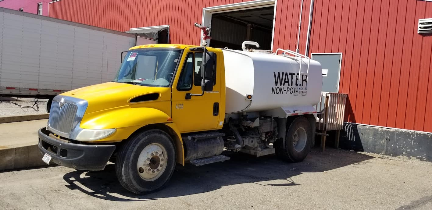 2004 International 4300 Tanker / Water Truck, VIN 1HTMMAAL45H116866, with DT 466 with Diesel Engine, Air Brakes & Automatic Transmission, 241,830 Metered Miles, with 2007 Curry Supply Company 2500 Gallon S/S Tanker, Model 902138, 5 Position Sprayer, with On-Board Pump, (Yellow)