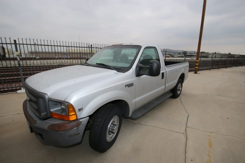 1999 Ford F250 Super Duty Silver Pick-Up Truck, with Triton V8 Engine, Vin #:  1FTNF20L1XEA17929, Plate #:  CA 5T91637, with 8' L Bed