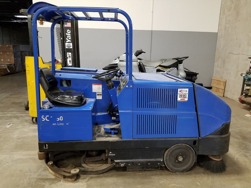 American Lincoln Sit-Down Electric Floor Scrubber, M/N 505-820, S/N 682107, with Head Lights (LOCATED IN FT. WORTH, TX)