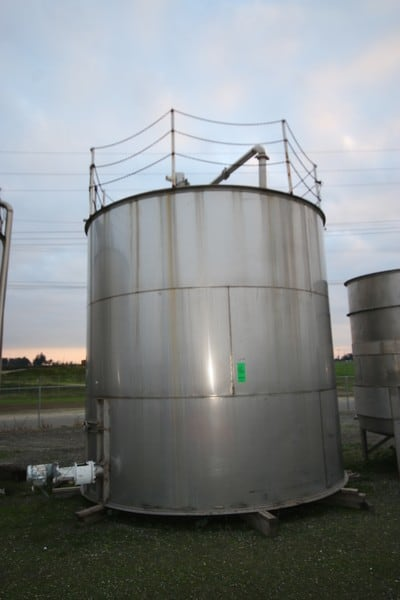 """Aprox. 10,000 Gal. S/S Single Wall Vertical Tank, with Side Man Door, with Top Mounted Chain Fence, with Side Mounted Motor, Tank Dims.: Aprox. 11' 11"""" Dia. X 12' 4"""" Tall (NOTE: Formerly Used As Waste Water Treatment Tank)"""