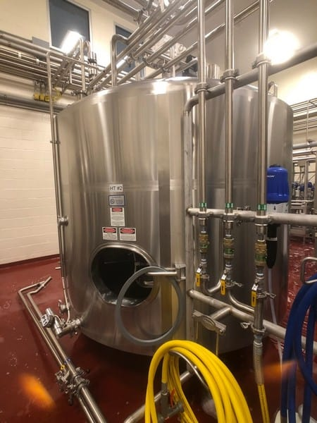 """Seitz Stainless 2,000 Gallon Insulated Sloped-Bottom Mixing Tanks, Avon MN 56310, S/N S96-8206-2, Top-Mount Sweep Agitation, CIP Spray Ball, Approx Dimensions: 7' 11"""" Internal Height, 6'1"""" Internal Diameter, 9' Total Height (Bottom of Legs to top of Agitator), 6'6"""" External Diameter, Air Valve Not Included ($500 Rigging and Loading Fee)(Located in Newville, PA) (HT #2)"""