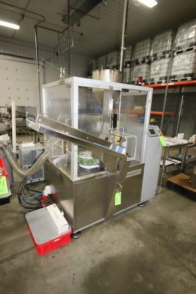 2010 Norden 18-Puck Tube Filler, M/N NORDENMATIC 602-HA, S/N S4801 & 54801, with Large Assortment of Norden Tube & Jar Pucks, with Assorted Norden Filler Parts
